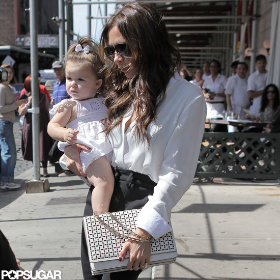 Victoria Beckham carried Harper Beckham in NYC.