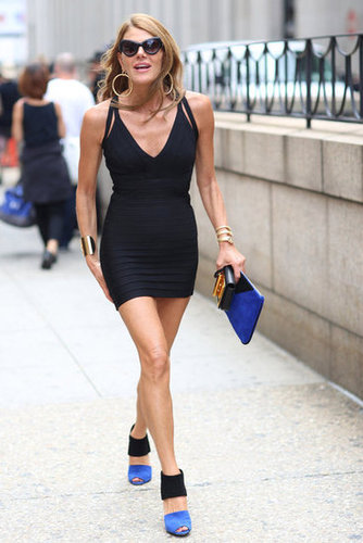 Anna Dello Russo marches on at Fashion Week in a body-con, leg-baring mini and colorblocked heels. Source: Greg Kessler