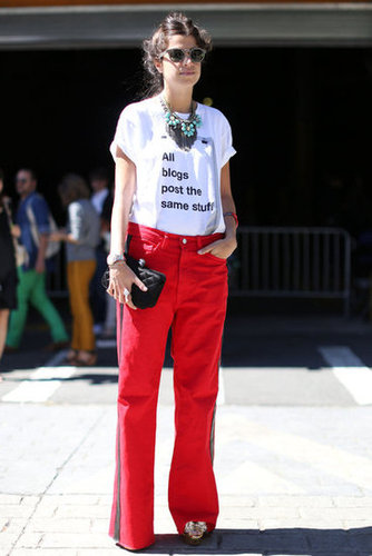 Leandra Medine outfitted a pair of red jeans with a statement tee.