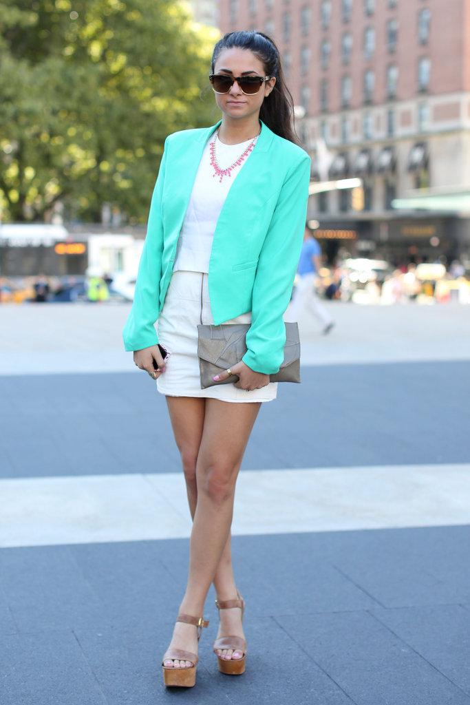 A turquoise blazer has maximum color impact against an all-white ensemble.