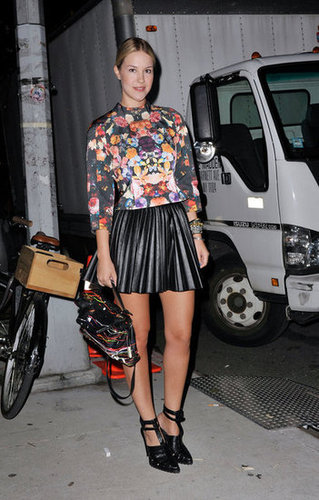 A pair of edgy Alexander Wang heels and a graffiti-print bag offset florals and girlier leather pleats.
