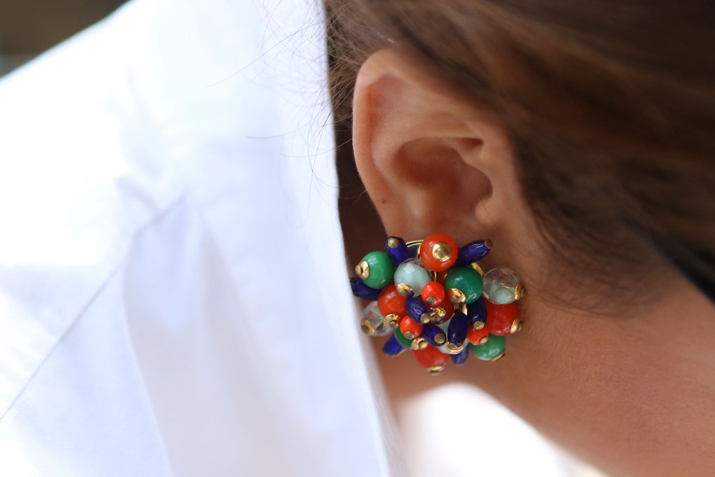 A fabulously beaded earring popped against a white button-down.
