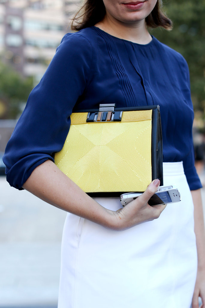 Streamlined clutches were seen all over the NYFW streets, but the lemon hue made this one especially fresh and chic.