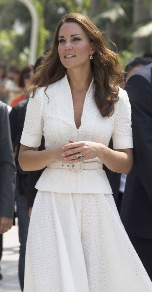 The Duchess wore a fitted top with cuffed short sleeves, with a belt for a fit-and-flare silhouette, plus diamond sapphire cluster earrings.
