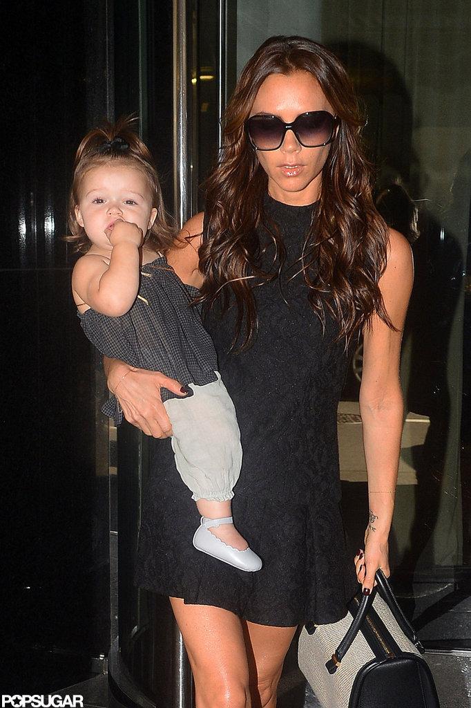 Victoria Beckham carried Harper Beckham in NYC.
