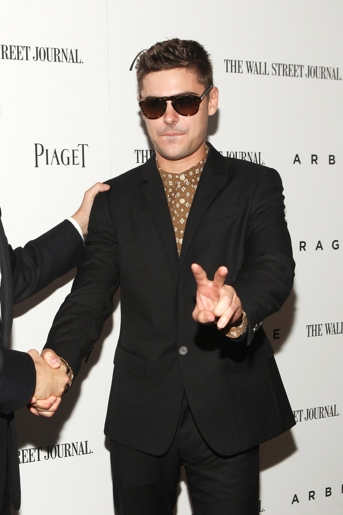 Zac Efron gave the peace sign on the carpet at the Arbitrage premiere in NYC.