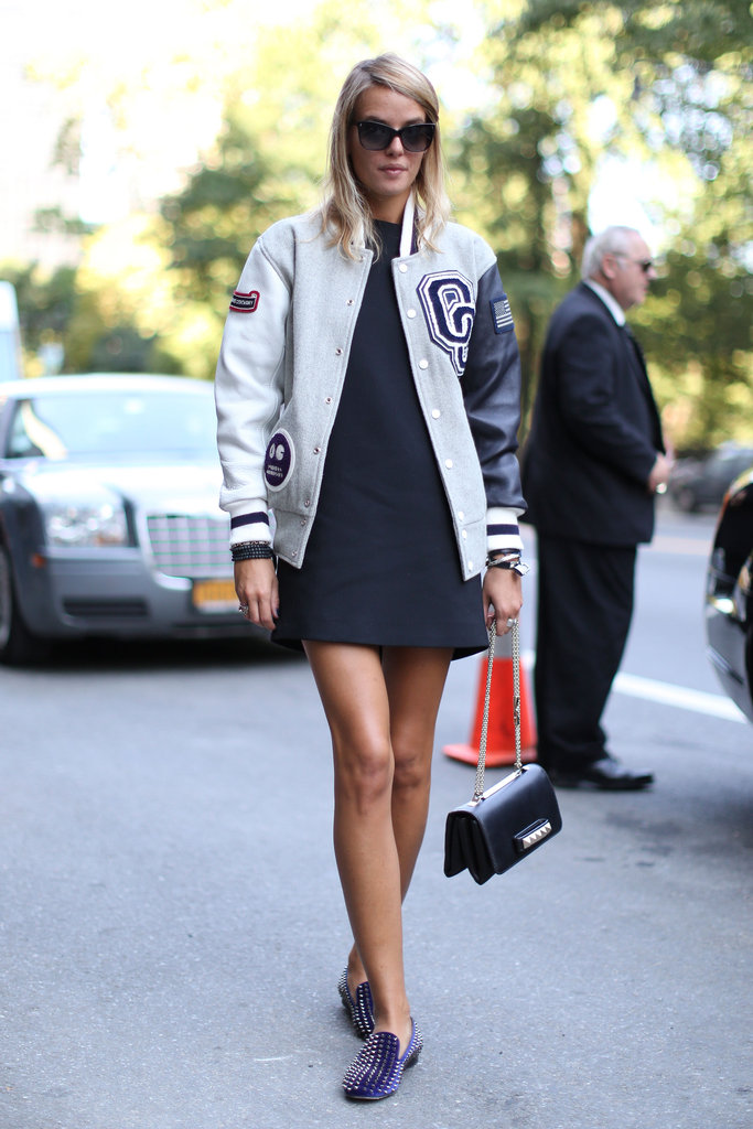 Varsity blues, the chicest way possible — with studded loafers and a chain-strap Valentino in hand.