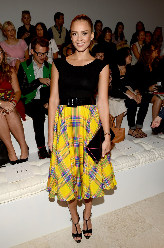 Jessica Alba looked totally adorable in a yellow plaid midi skirt for the front row at Ralph Lauren.