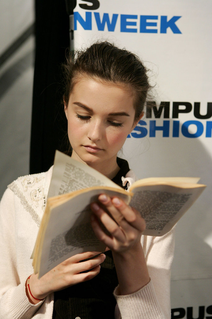 A model read a book without a cover at Matthew Earnest's Spring 2006 show.