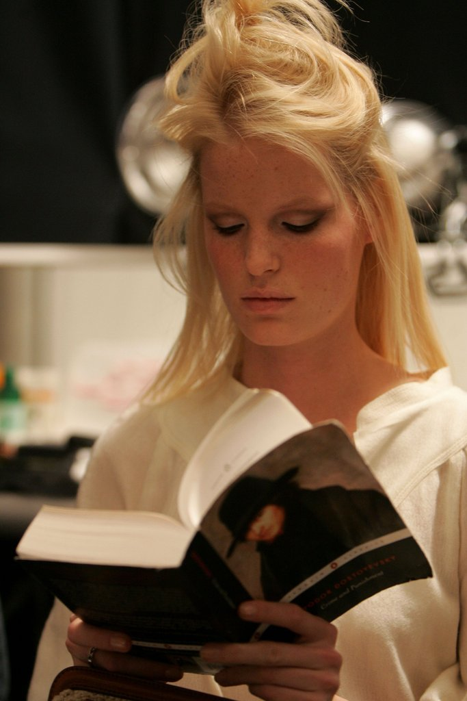 This blond model went for the Russian novel Crime and Punishment by Fyodor Dostoyevsky before she walked the runway at the Carolina Herrera Fall 2006 fashion show during New York Fashion Week.