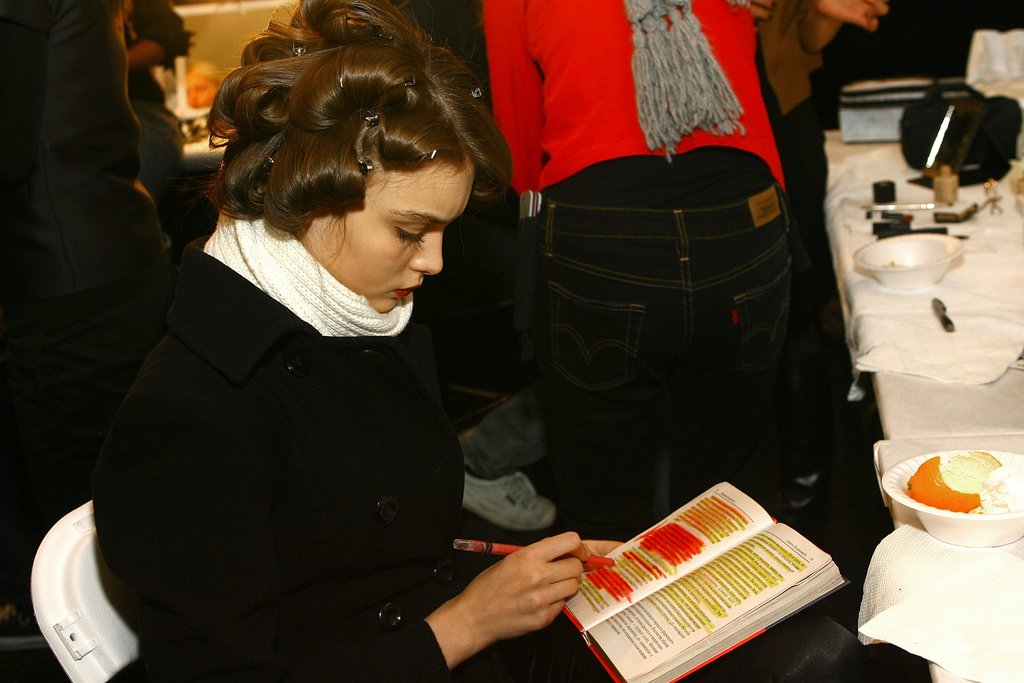 A model highlighted her book backstage at the J Mendel Fall 2007 fashion show during Mercedes-Benz Fashion Week.