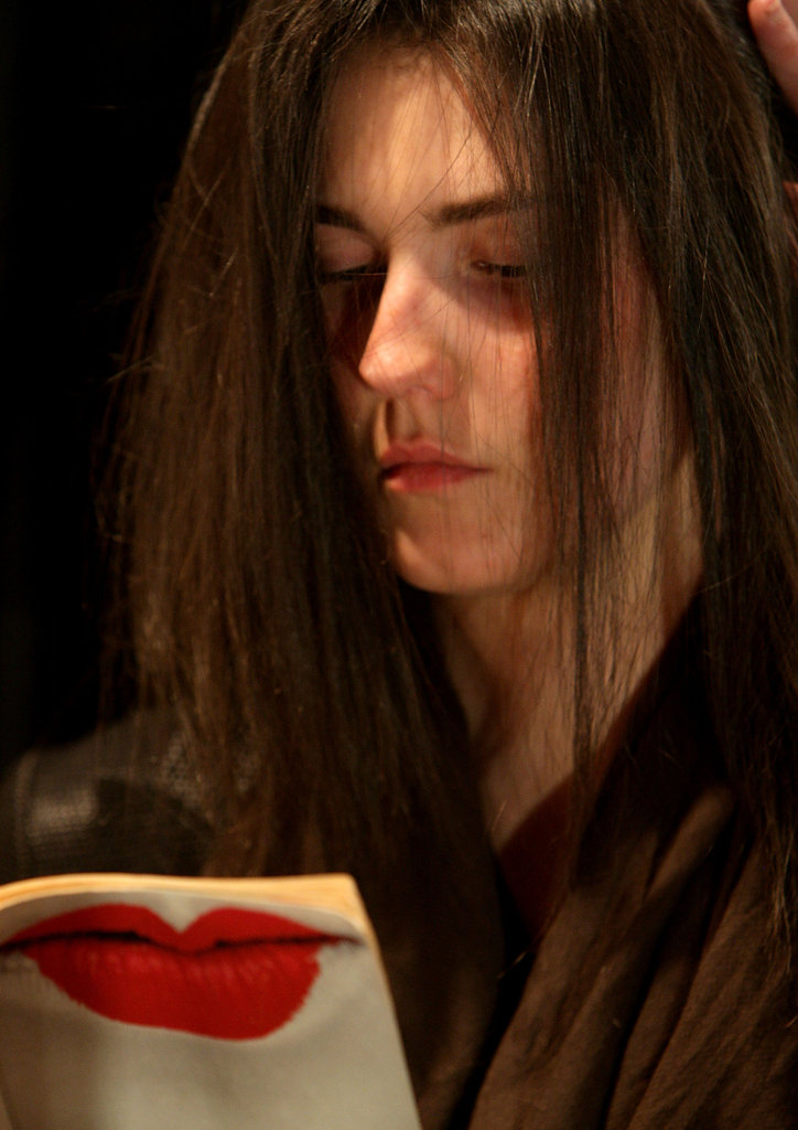 This model got her hair done while reading a book during Rosemount Sydney Fashion Festival in 2010.