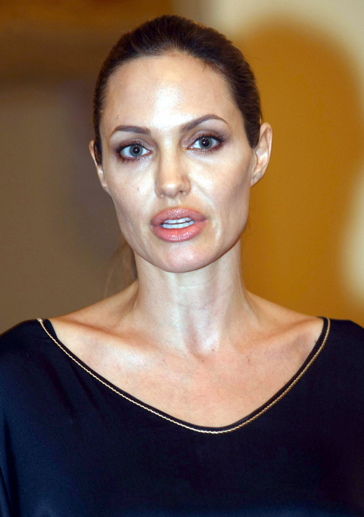 Angelina Jolie wore her hair pulled back.