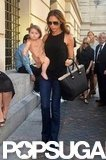 Victoria Beckham carried Harper on her hip.