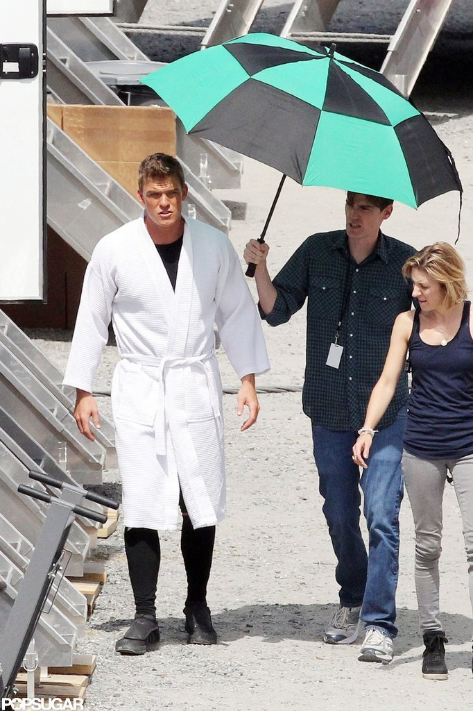 Alan Ritchson wore a robe on the set of Catching Fire.