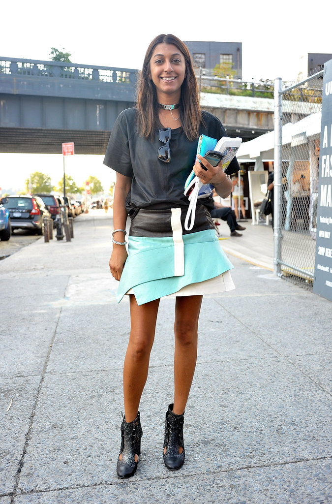 This styler, um, wrapped up her look with a bold, architectural skirt and glittered booties.