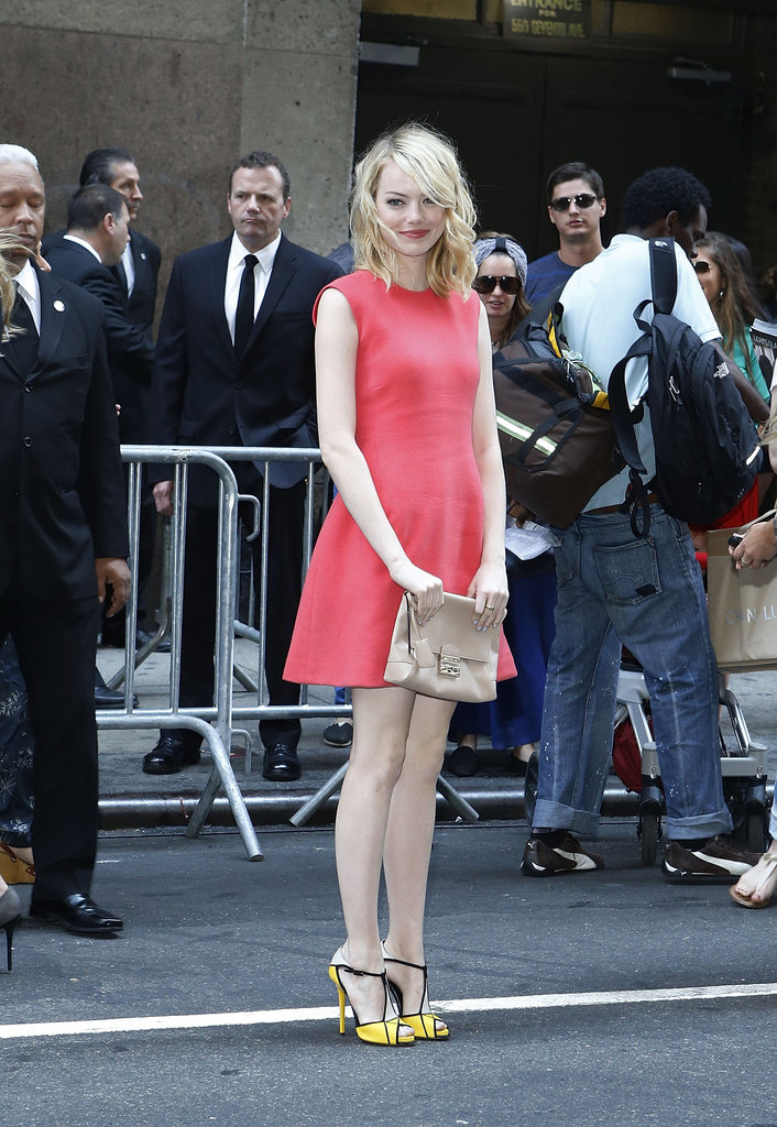 Emma Stone looked radiant in a coral-colored dress as she arrived for the Calvin Klein show.