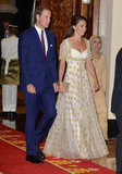 For a dinner with Malaysia's head of state, Kate chose a gold and white style that moved gracefully as she walked.