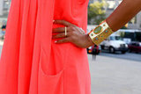 A jeweled gold cuff added more whimsy to this flowy, bright dress.