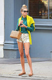 Jessica Hart made the most of NYC's late-Summer heat in floral Citizens of Humanity shorts, a bright green button-down, and a neon yellow sweater.