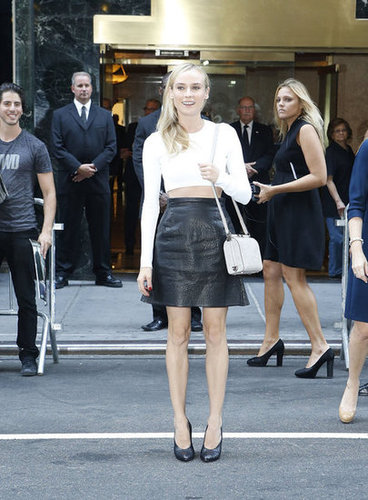 Diane Kruger wore a white crop top and black leather skirt as she arrived at the Calvin Klein show.