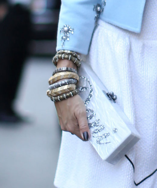 A glamorous clutch — and the glamorous arm candy to match. Source: Greg Kessler