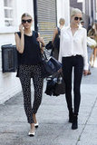 Color-coordinated model friends in two equally chic white and black looks — how sweet are those polka-dot pants?