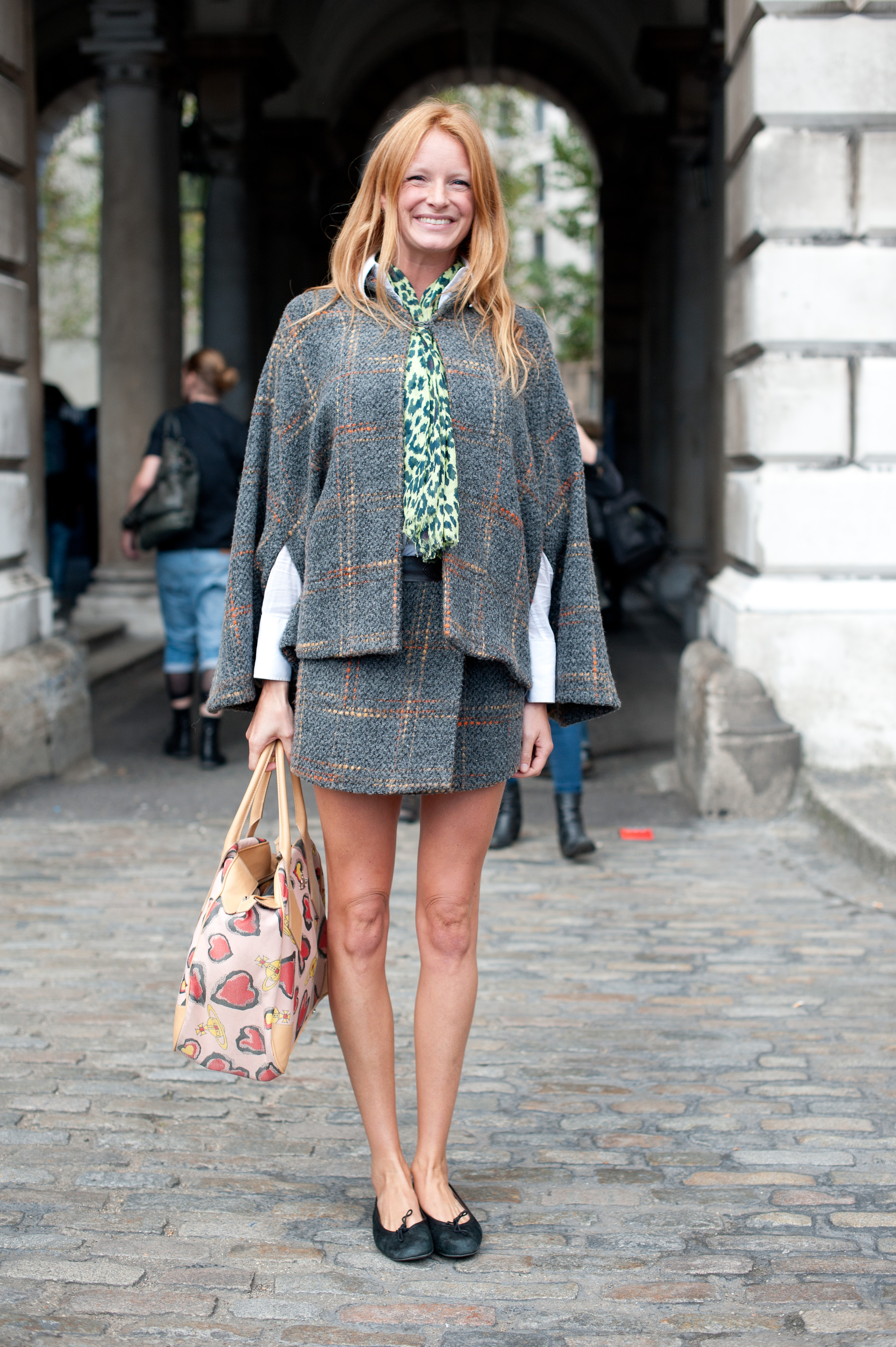 Tweedy plaid separates made an appearance, along with a pair of sweet ballet flats. Despite what you may think about dressier tweed looks, the poncho-inspired top provided a less-formal feel.