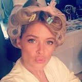 Doutzen Kroes channelled a '50s housewife with her gorgeous skin and hair in rolls. Source: Instagram user doutzenkroes1