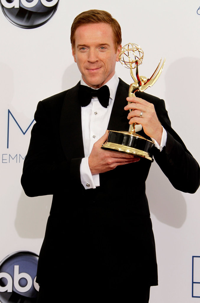 Homeland's Damian Lewis held up his Emmy after the show.