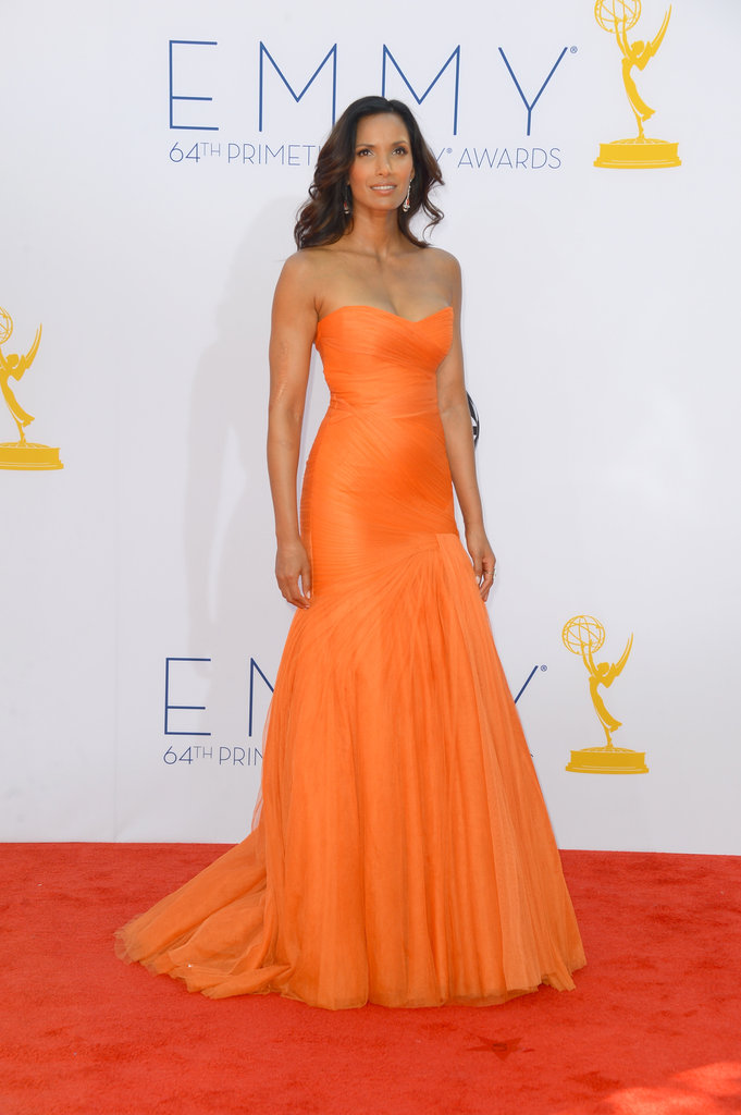 Padma Lakshmi stepped onto the red carpet in an orange gown.
