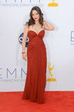 Kat Dennings worked a revealing neckline on her J. Mendel gown that gave her Emmys look a glamorous Old Hollywood feel.