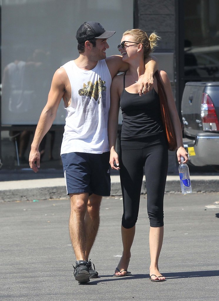 Josh Bowman walked with his arm around Emily VanCamp.