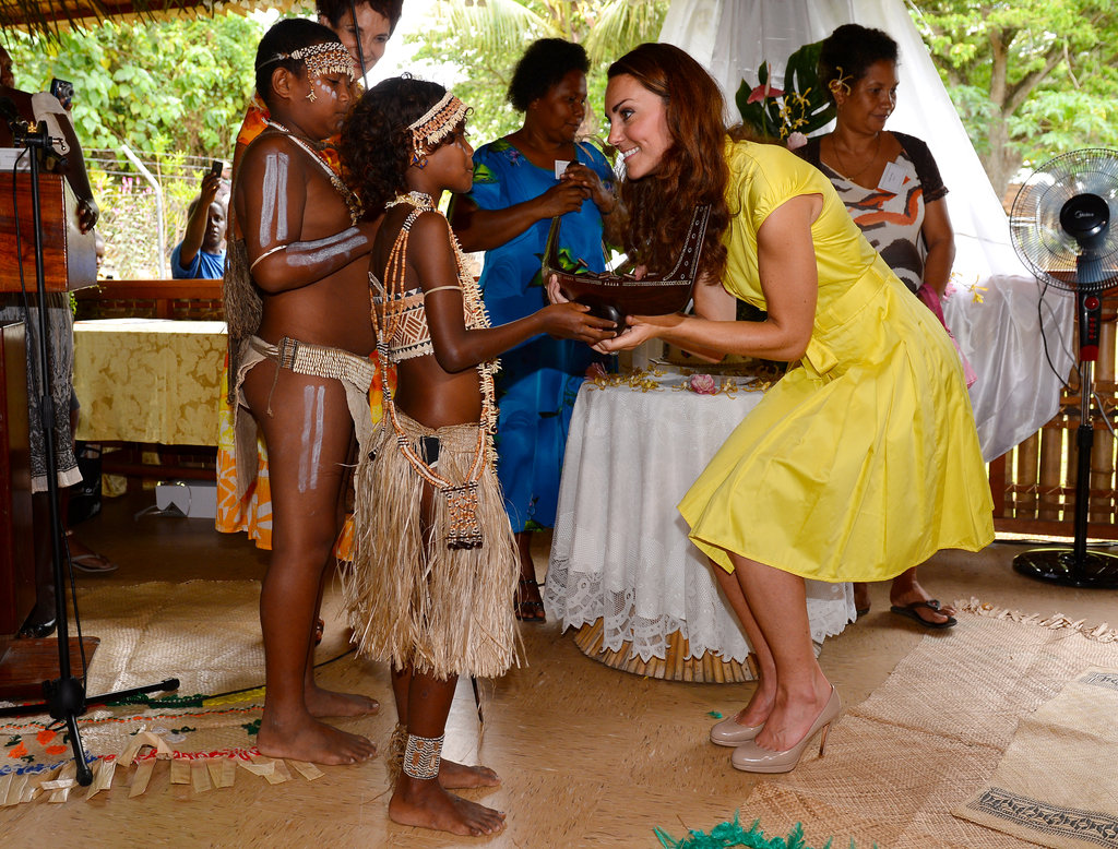 Kate Middlton wore a bright yellow Jaeger dress to meet with women who work in local public service at the Leaf House in Solomon Islands.