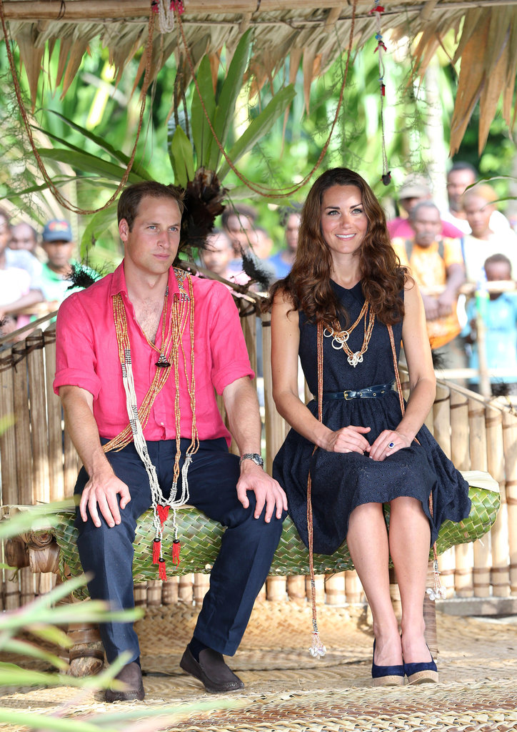 Kate Middleton wore a navy blue Mulberry dress while Prince William wore a bright pink t-shirt.