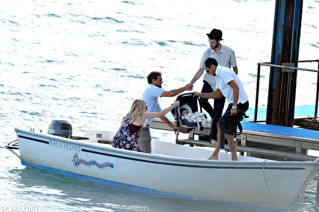 Baby Marlowe was handed to mom Sienna Miller as dad Tom Sturridge boarded a boat behind them.