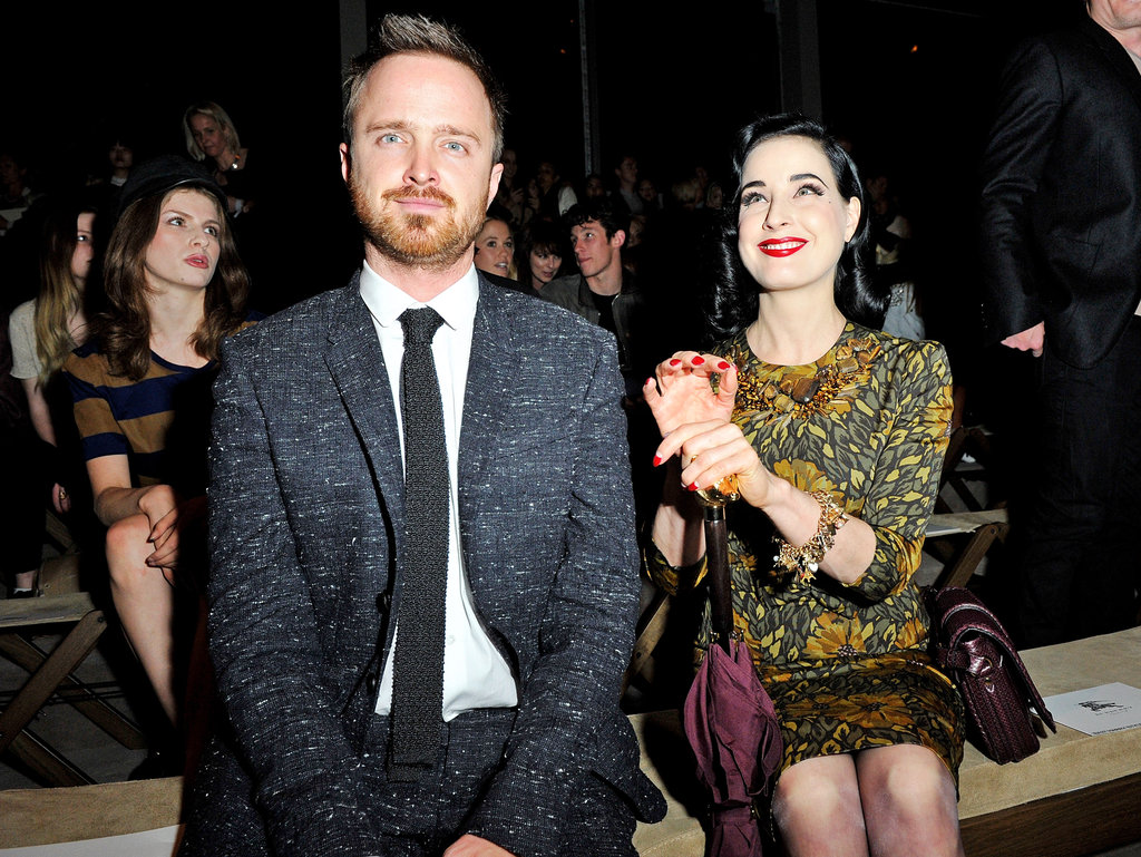Aaron Paul and Dita Von Teese attended the Burberry Spring Summer 2013 womenswear show.