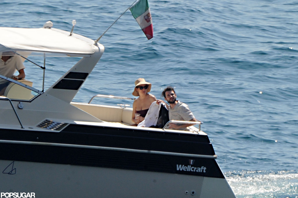 Tom Sturridge and Sienna Miller took a small boat to a larger one in Positano.