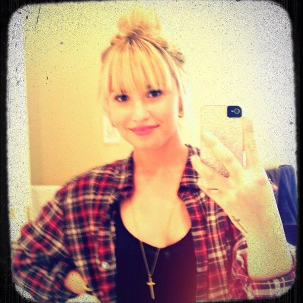 Demi Lovato snapped a pic of her new bangs.  Source: Instagram user demilovat