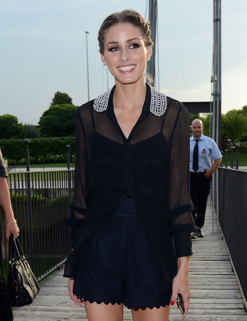 Olivia Palermo's embellished collar added interest to a sheer black button-down.