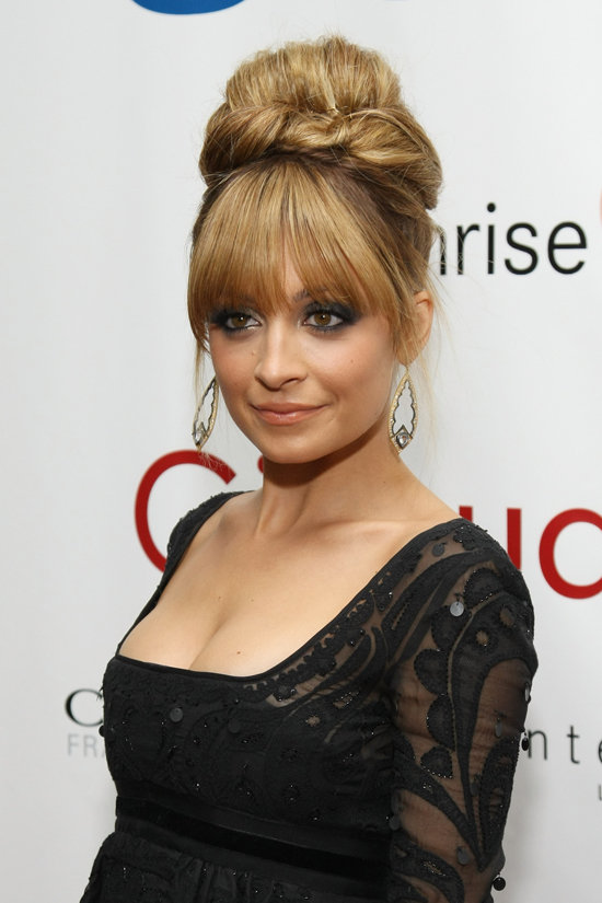 All eyes were on Nicole's oversize updo at the 2012 FiFi Awards. She finished the glamorous look off with a sultry smoky eye and below-the-brow bangs.