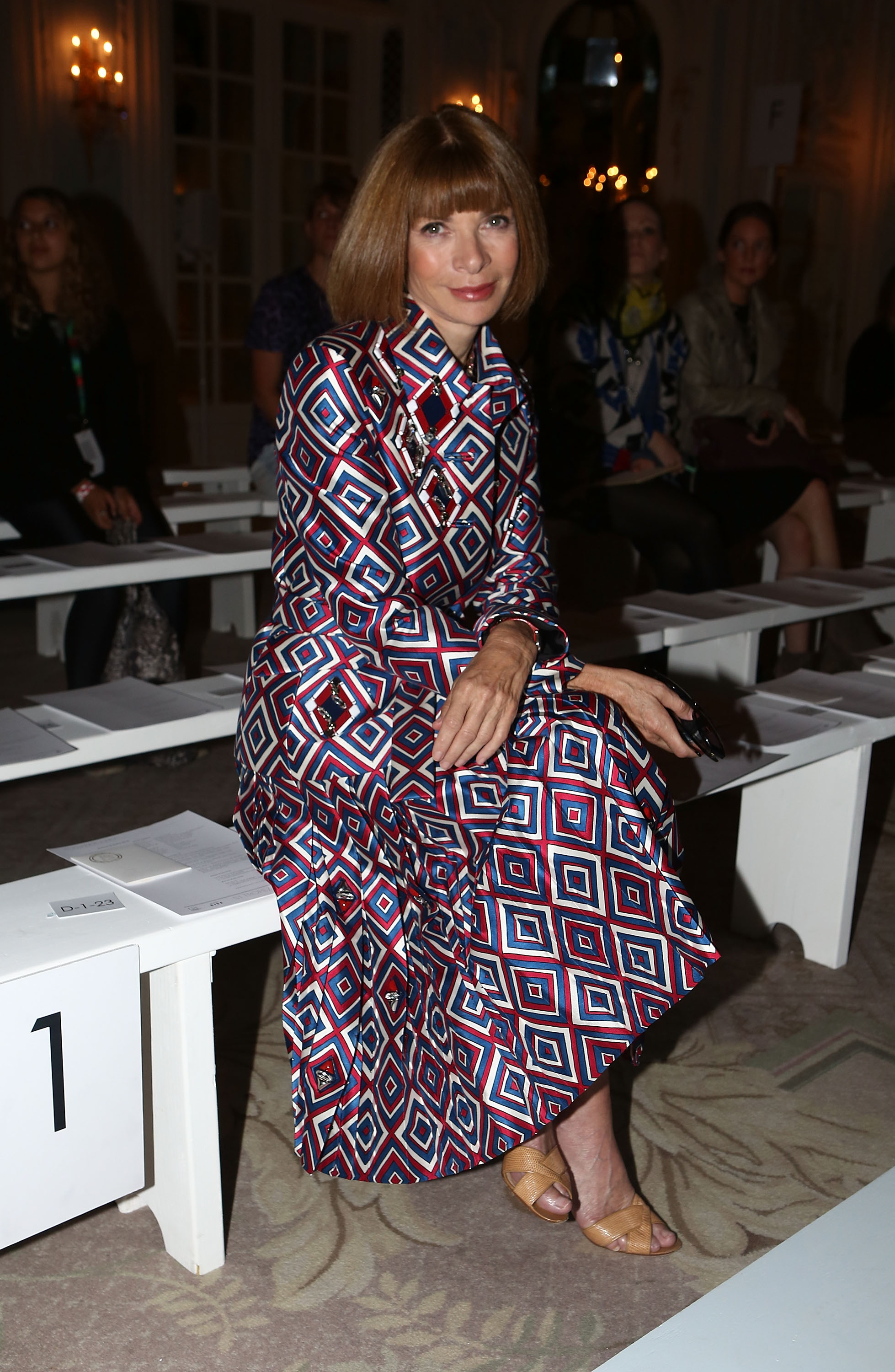 Anna Wintour took front row at Roksanda Ilincic's show at London Fashion Week in a geometric-print coat dress.