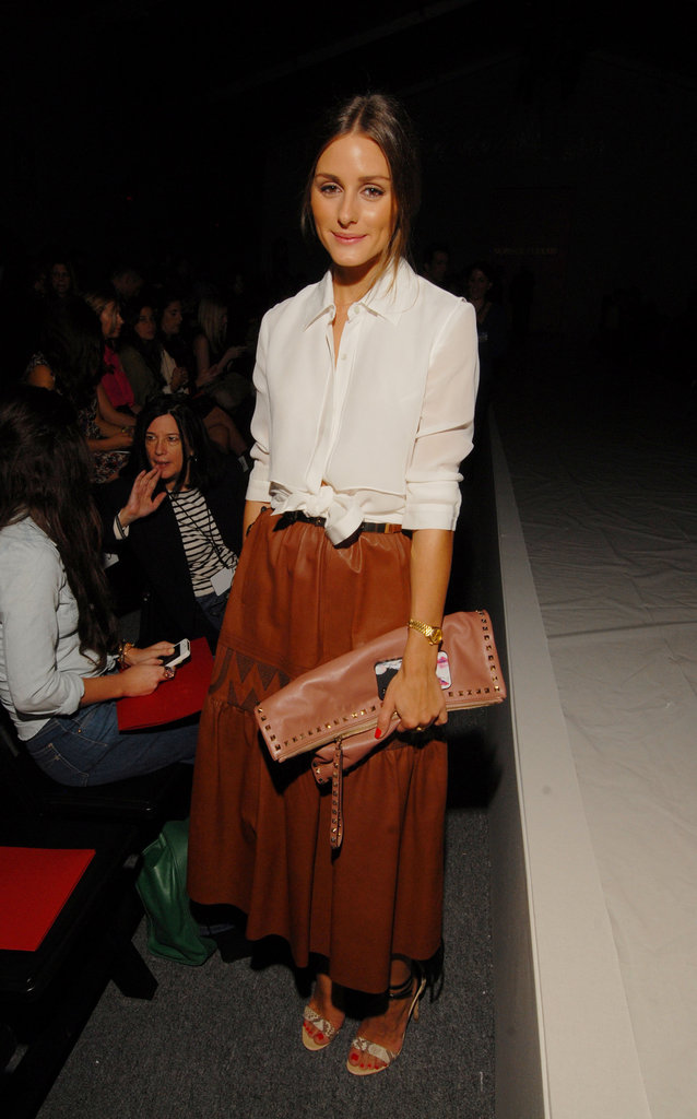 Leave it to Olivia to give us a new favorite way to wear leather. At the Norisol Ferrari show in NYC, Olivia gave leather a ladylike spin with a vintage leather midi skirt and a white blouse, which she finished with understated Tibi ankle-strap heels. 8762083