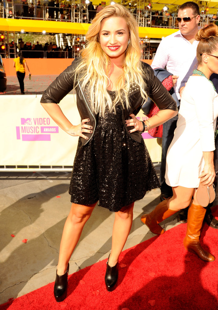Demi covered up her black sequin Topshop dress with a black studded leather biker jacket like this Asos black studded biker jacket ($259) at the 2012 MTV Video Music Awards in LA.