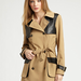 We love the cool leather accents on this dark camel trench.