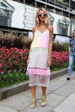 Quirky pink shades offset a pretty, pastel colorblocked slip dress.