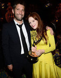 Julianne Moore cuddled up to her award — and her husband, Bart Freundlich — after the Emmys.