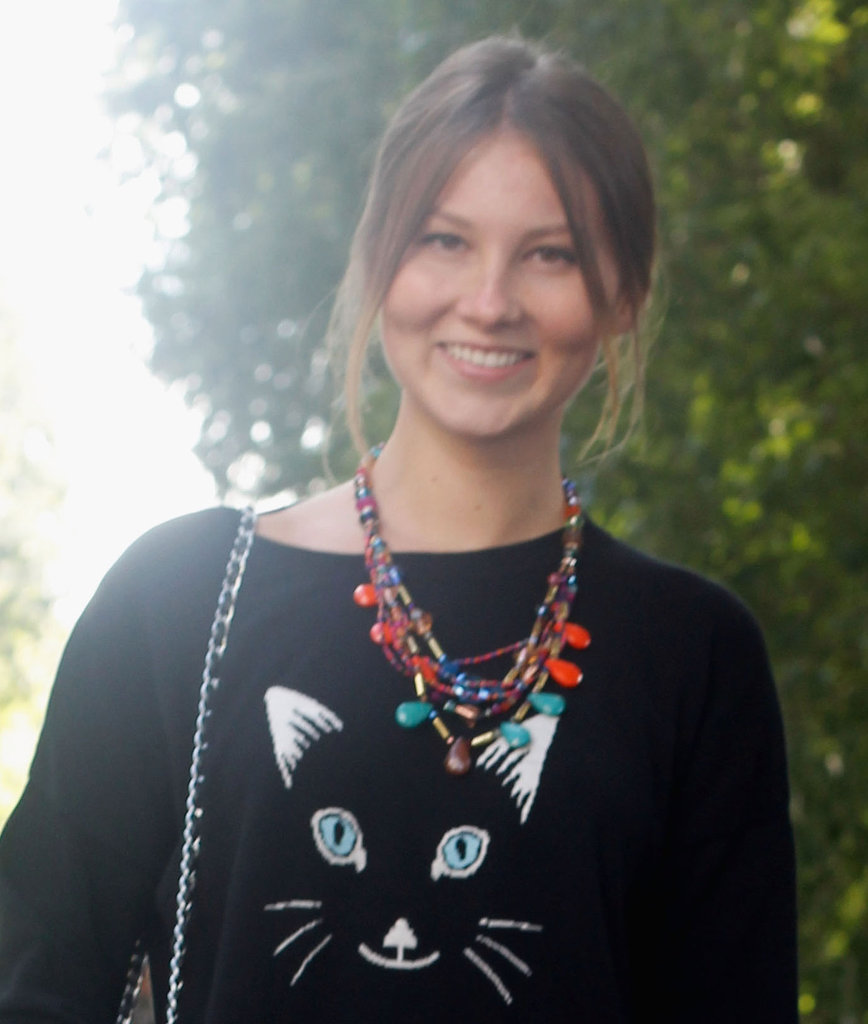 A cat-face sweater got a cool counter in these layered necklaces. Source: IMAXtree