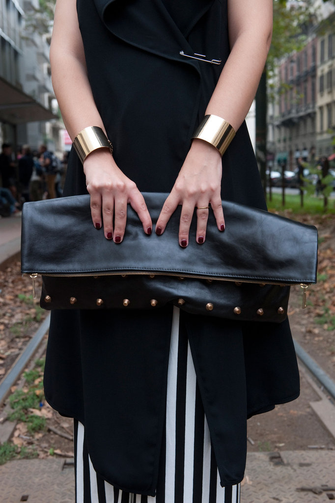 An oversize clutch got a tough-girl touch via studs and this styler's matching gold cuffs. Source: IMAXtree