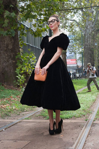 A black dress cinched at the waist, full skirted, and adorned with puffy cap sleeves? This is an avant-garde princess moment. Source: IMAXtree